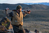Hunter rest during his chukar hunt to enjoy the scenery.
