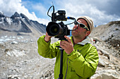Photographer Marc Pagani sets his camera for video and sound as he shoots an expedition to climb Mount Everest in the Nepal Himalayas