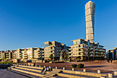 People sitting on a square, Turning torso in the rehabilitated harbor area, Malmo, Southern Sweden, Sweden