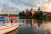 Gripsholm Castle and marina with blond boy in the foreground, Sweden