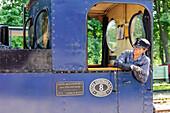 Railway station with historical steam railway. Locomotive driver looks like Jim Knopf, Sweden
