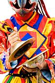 Asian man wearing mask playing musical instrument
