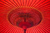 Close up of underside of red umbrella