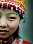 Close up of Asian girl wearing traditional hat
