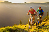 Caucasian couple mountain biking