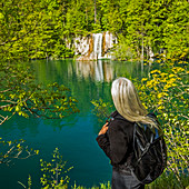 Older Caucasian woman admiring waterfall