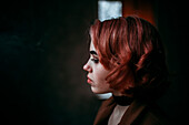 Pensive Caucasian woman with red hair