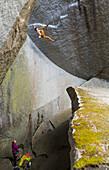 Girl watching boy rock climbing