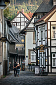 UNESCO World Heritage historic old town of Goslar, couple in love strolling through small alleys of the old town, Harz mountains, Lower Saxony, Germany