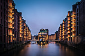 UNESCO World Heritage Speicherstadt - warehouse dock, castle at dusk, Hamburg, Germany