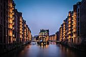 UNESCO World Heritage Speicherstadt - warehouse dock, castle at dusk, Hamburg, Germany