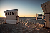"""UNESCO World Heritage """"the Wadden Sea"""", beach chairs during sunset at St. Peter-Ording, Schleswig-Holstein, Germany, North Sea"""