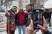 Smartphone photograph of Asian tourist posing next to men in Roman gladiator costume, Split, Split-Dalmatia, Croatia