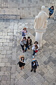 Overhead of Asian tourists in Old Town seen from bell tower of Cathedral of St. Lawrence, Trogir, Split-Dalmatia, Croatia