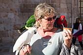 Woman holds parrots in Dubrovnik Old Town, Dubrovnik, Dubrovnik-Neretva, Croatia
