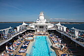 People enjoy a sunny afternoon on Pooldeck of cruise ship Mein Schiff 6 (TUI Cruises), Baltic Sea, near Rønne, Bornholm, Denmark
