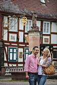 Couple enjoys stroll through Altstadt old town, Bad Orb, Spessart-Mainland, Hesse, Germany