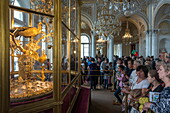 Crowds admire art in The Hermitage (Eremitage) museum complex, St. Petersburg, Russia