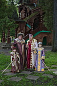 Family in traditional period costumes pose for photographer, Uglich, Russia