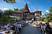 People enjoy Frankenwein Franconian wine at Weinfest am Rödelseer Tor wine festival, Iphofen, Franconia, Bavaria, Germany