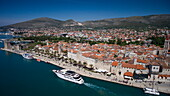 Aerial of cruise ship MS Romantic Star (Reisebüro Mittelthurgau) and Old Town rooftops, Trogir, Split-Dalmatia, Croatia
