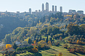 townscape, cypresses, San Gimignano, hilltown, UNESCO World Heritage Site, province of Siena, autumn, Tuscany, Italy, Europe