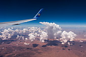 Aerial of wing and winglet of Condor B-767-300ER (D-ABUB) during flight from Frankfurt to Las Vegas with cloud and desert landscape, above Utah, USA