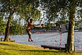 Slackliner on the island Skeppsholmen, Stockholm, Sweden