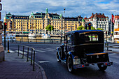 noble houses on the beach and vintage cars in the foreground, Stockholm, Sweden