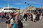 People board a steamboat in Stockholm, Stockholm, Sweden