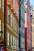blue sky reflected in windows in alleys of the old town Gamla Stan, Stockholm, Sweden