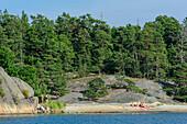 Sunbathing in the Scharengarten Fiskhamn Island, Stockholm, Sweden