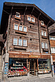 chalet with a souvenir shop on the ground floor in the town centre of zermatt, ski resort, zermatt, canton of valais, switzerland