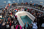 festive ceremony upon crossing the arctic circle aboard the astoria cruise ship, greenland