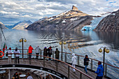 passengers on the ocean liner's deck to admire the landscape, the blue glacial snout of the glacier, astoria cruise ship, fjord in the prince christian sound, greenland