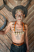 Wangchah Wangsa, Naga headhunter, with tattooed face and tribal necklace, and chest tattoo marking him as having taken heads, Nagaland, India, Asia