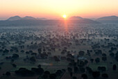 Sun rising over the hills and countryside surrounding Samode, from hot air balloon, Rajasthan, India, Asia