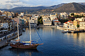 Attractive harbour and town backed by mountains, from Mirabello Bay, Agios Nikolaos, Lasithi, Crete, Greek Islands, Greece, Europe