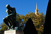 'France, Paris 7e area, in the garden of the Rodin Museum, the statue ''le Penseur'' with in background the golden Invalides dome'