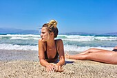 Young woman laying at the beach, Dutch ethnicity, At holiday destination Chrissi Island, Crete, Greece