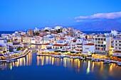 Agios Nikolaos Harbour from an elevated angle at dusk, Agios Nikolaos, Crete, Greek Islands, Greece, Europe