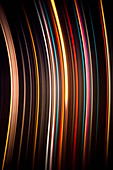 Abstract image of colorful light trails against black background