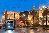 Avenue of the Constitution - Cathedral and Metrocentro tram, Seville, Region of Andalusia, Spain, Europe.