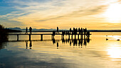 romantic sunset on the jetty with mountainview, lake Ammersee, Bavaria, Germany