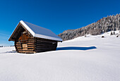 beautiful winter weather and fresh snow and on a barn near Wagenbrüchsee, Bavaria, Germany