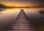 long jetty at the east bank of lake Ammersee, Bavaria, Germany
