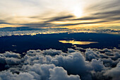 lake Chiemsee reflects the golden light of the sunset, aerial shot, Bavaria, Germany