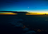 the moon above a thunderstorm, taken shortly after sunset, aerial shot, France