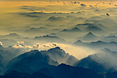 haze in the valleys of the alps gives this aerial shot a three-dimensional depth. Sunset above the Salzburg region, Austria