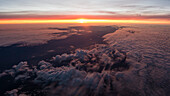 sunset from a bird's-eyes view above the high inversion fog, northern Germany